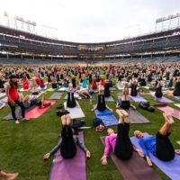 Hundreds of people doing yoga on Wrigley Field with Lululemon